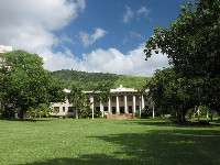 Graceful Hawaii Hall and the huge green lawn in front.