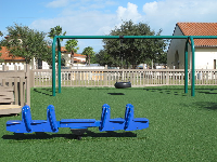 Blue see-saw and tire swing.