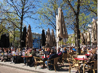 Many people gather for coffee at the square.