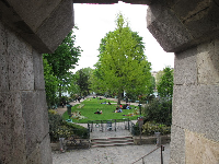 Looking through a window in the bridge, at the park below.