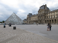 The large pyramid, one of the smaller pyramids, and the Louvre Museum.
