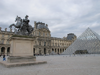 Statue, pyramid, and Louvre Museum.