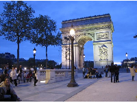 The magical look of the Arc de Triomphe from the Champs-Elysee at night.
