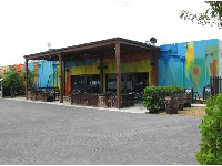 R House restaurant, with colorful walls and outdoor seating on a patio.