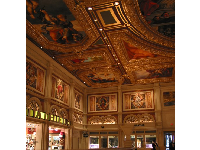 Painted walls and ceiling, with plenty of gold trim.