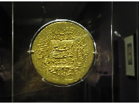 Gold presentation coin from India.