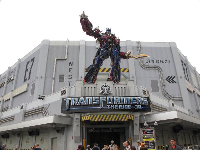 The statue above the transformers ride.