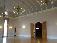The ballroom with its carved wooden doors and interesting chandeliers.