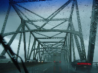 Driving across the Mississippi River in the rain.
