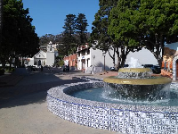Lovely blue-tiled fountain, with the mission in the background.