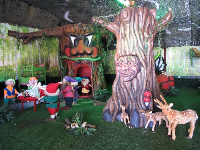 Indoor play area with forest theme.