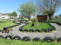 Long go-kart area with tires as barriers.