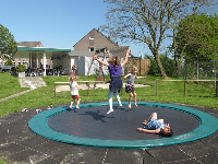 Girls enjoying the round trampoline.