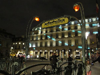 Gothic metro station at night called Palais Royal, right by the Louvre Pyramid.