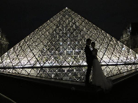 Wedding at the pyramid at night.