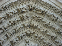 Engravings of saints above the doorway to Notre Dame.