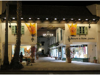 The entrance to El Paseo, at night.