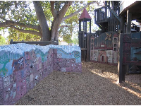 Wall with shells and engravings in the toddler area.