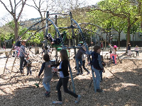 Kids playing on the space-age playground.