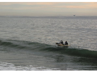 Surfers return to Gaviota Beach by dinghy after trying to sneak a few rides on waves at Hollister Ranch, just west of Gaviota Beach.