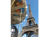 The adorable two-storey carousel which is below the Eiffel Tower, near the Seine river.