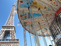 The two-storey carousel below the Eiffel Tower.