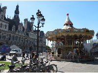 The two-storey carousel in front of the gorgeous Hotel de Ville, nearby.