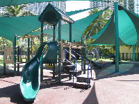 The playground has green shade canopies that catch the light in a pretty way!