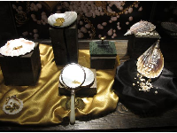 Jewelry, jade, and coins discovered in 2007, along with a lead box containing 16,184 natural pearls.