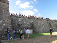 Hundreds of people gather to watch the firing of the cannons.