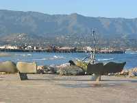 Whale seats, and a little dolphin statue at the end of the breakwater!