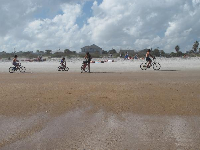 Family biking on the beach!