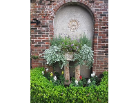 Planter and brick arch.