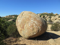 A round boulder and shadow.
