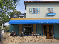 Splash Cafe has a colorful building and a lovely front patio.