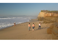 College students and families gather at Pomponio Beach.