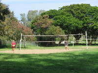 Two girls play volleyball.