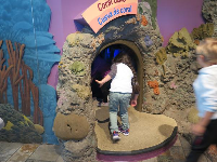 Kids like to go inside the coral cave.