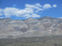 Amazing hills and puffy clouds, as seen from the road 20 minutes north of Lone Pine.