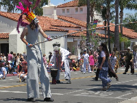Man on stilts in the Summer Solstice Parade 2017.