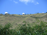 Like three giant golf balls on the top of the mountain- part of the military base.