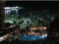 The pool, beach, and jetty at night.