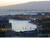 Dusk at Ala Moana Beach Park, as seen from Kalia Tower in the Hilton Hawaiian Village.