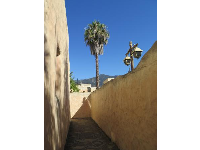 High adobe walls.