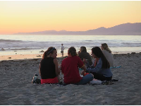 Group of friends at Coal Oil Point at sunset.