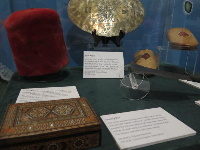 Berber jewelry box purchased in North Africa, and fez worn by the French Morocco Colonial Forces with tassel color depending on wearer's rank.