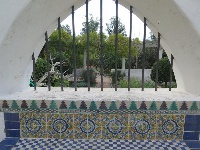 Looking past a tilework seat to the herb garden.