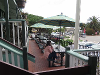 Picnic tables on the front balcony, at Summerland Beach Cafe.