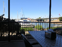 Outdoor tables by the water at Topper's Pizza.
