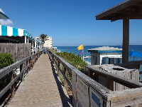 Boardwalk in front of Dune Deck Cafe.